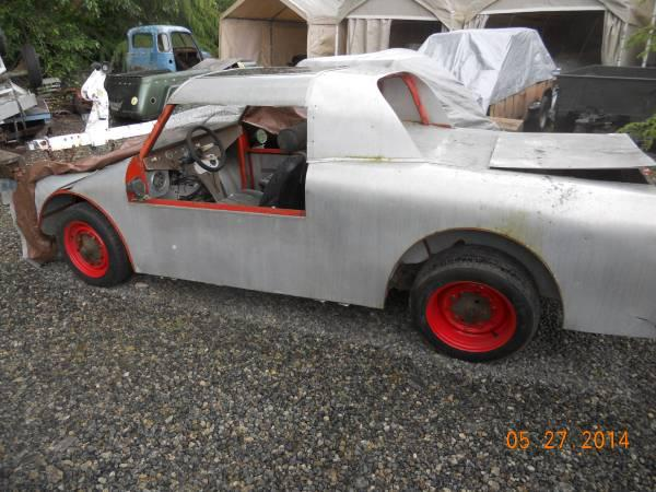 Handbuilt aluminum body on VW rolling chassis...wow ...